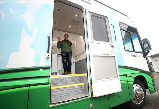 Peninsula Community Health's associate medical director, Anthony Lyon-Loftus, is framed in the doorway of its new mobile primary care unit. PCHS has introduced the clinic on wheels to Kitsap County, serving patients who can't make it into a brick-and-mortar clinic.
