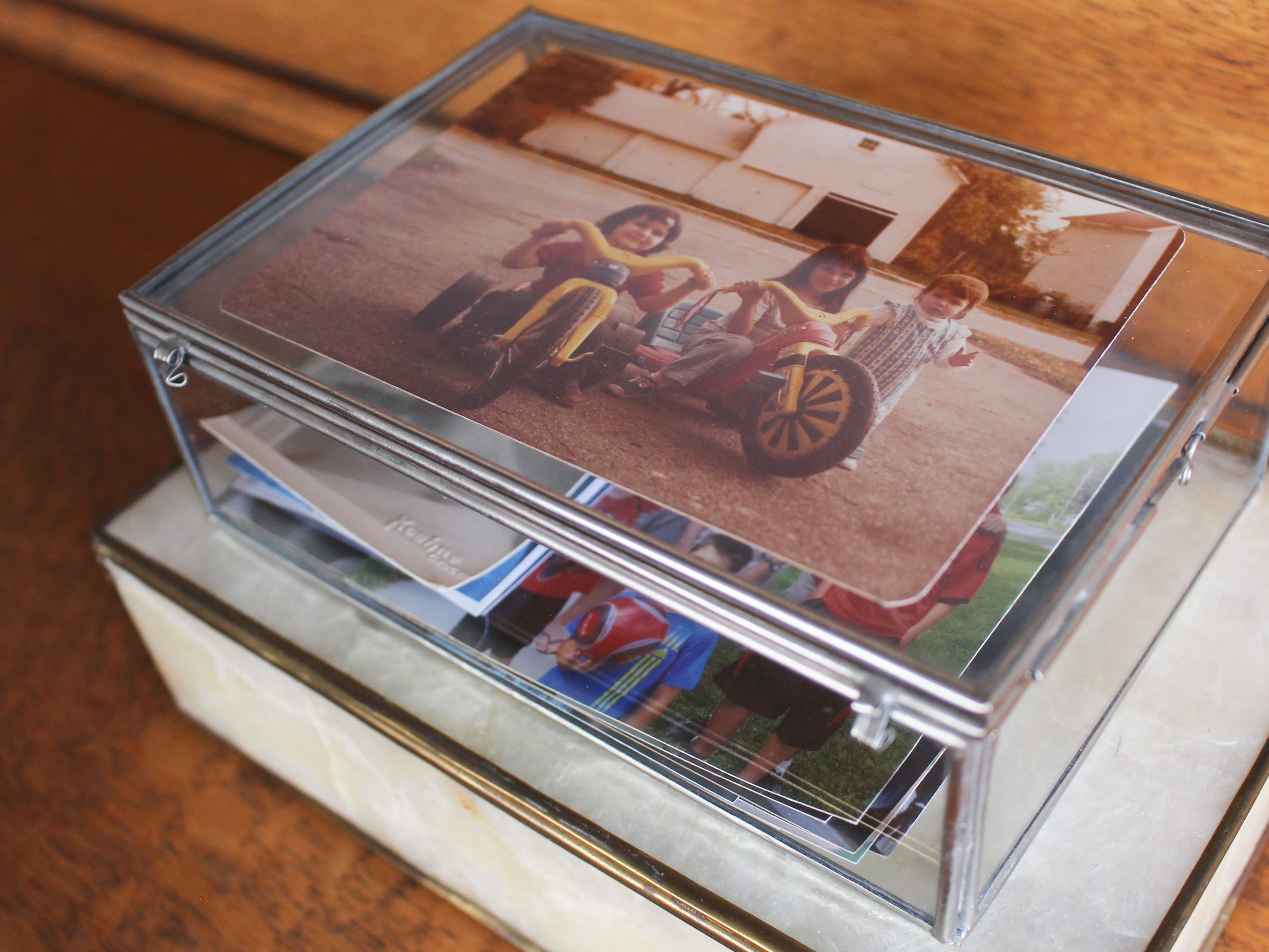 Special containers offer a way to store photos but make them accessible for viewing.