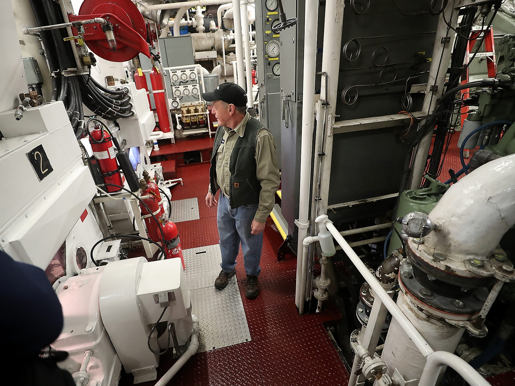 Tillikum Staff Chief Peter Miele moves through one of the engine rooms during a tour aboard the vessel at the Eagle Harbor Maintenance Facility on Bainbridge Island on Wednesday, February 27, 2019.