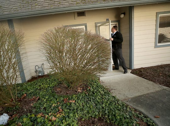 Todd Hildebrand, community director of The Landings at Jackson Park, exits one of the model homes.