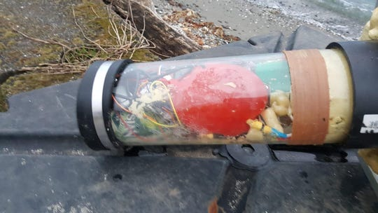 "A picture of the ""suspicious item"" found along Manitou Beach Drive that police are investigating."