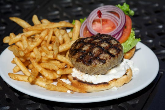 Coasters, with locations on Eau Gallie Boulevard and in Cocoa Beach, is loved for its classic burgers as well as less traditional ones, like this Greek lamb burger with tzatziki and feta cheese.