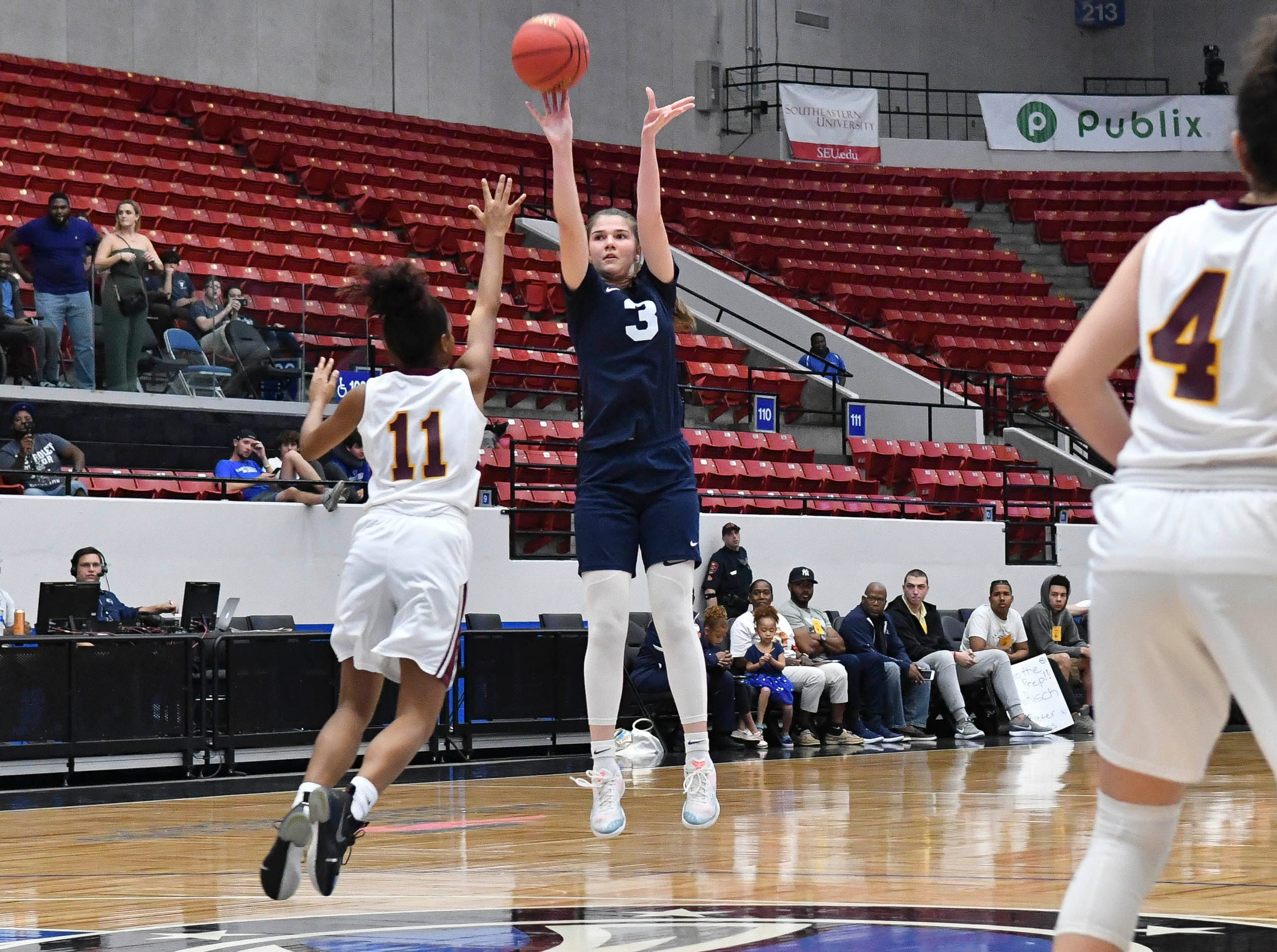 Antonia Alexe of Florida Prep launches a three pointer over Sierra Bell of Bayshore Christian during Tuesday's Class 2A state championship game.