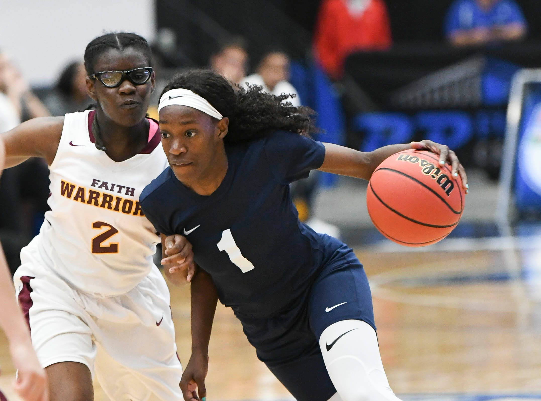 Jayla Johnson of Florida Prep drives to the hoop past Ari Royal of Bayshore Christian during Tuesday's Class 2A state championship game.