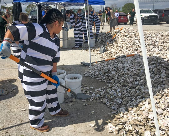 Trustees at the Brevard County jail bag oyster shells for a lagoon cleanup project with the Brevard Zoo.