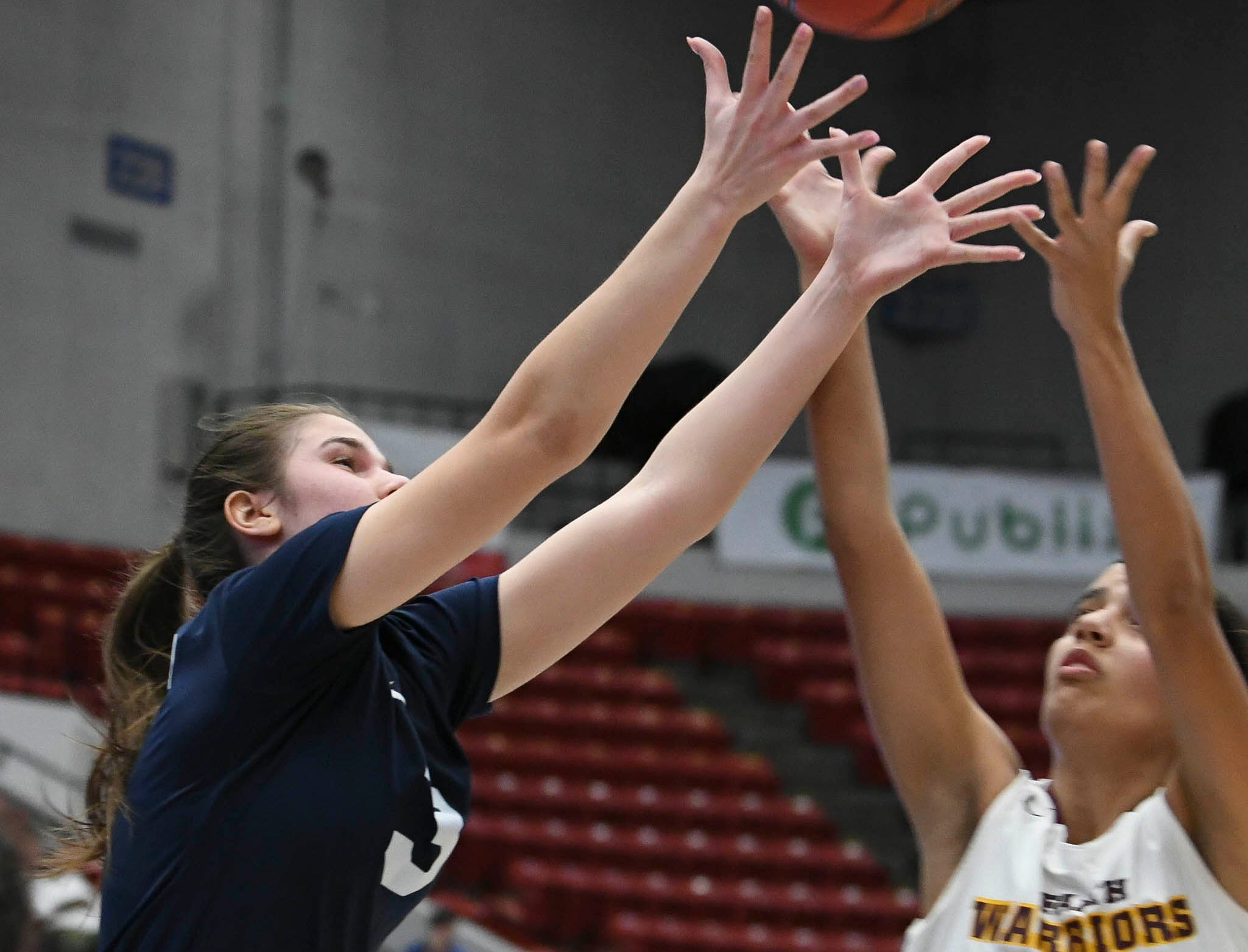 Antonia Alexe of Florida Prep fights for a rebound with Bayshore Christian's Fabiana Limongi during Tuesday's Class 2A state championship game.