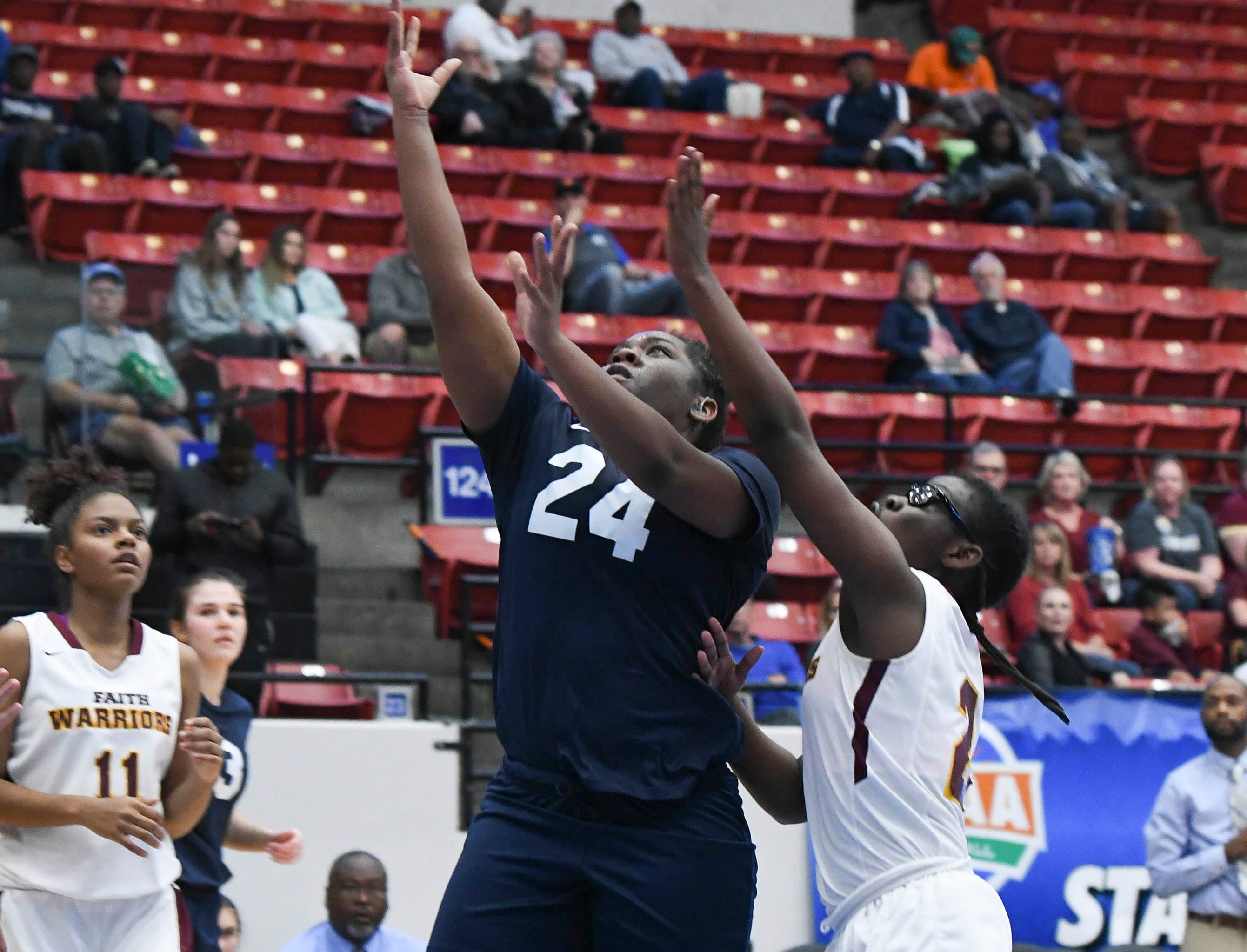 Ashaunti Rolle of Florida Prep shoots over Bayshore Christian defender Ari Royal during Tuesday's Class 2A state championship game.