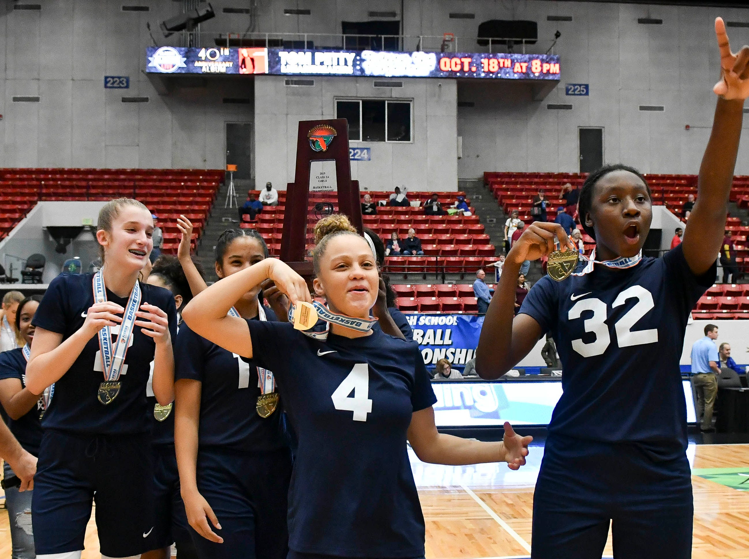 Florida Prep players celebrate their 67-35 victory over Bayshore Christian in Tuesday's Class 2A state championship game.