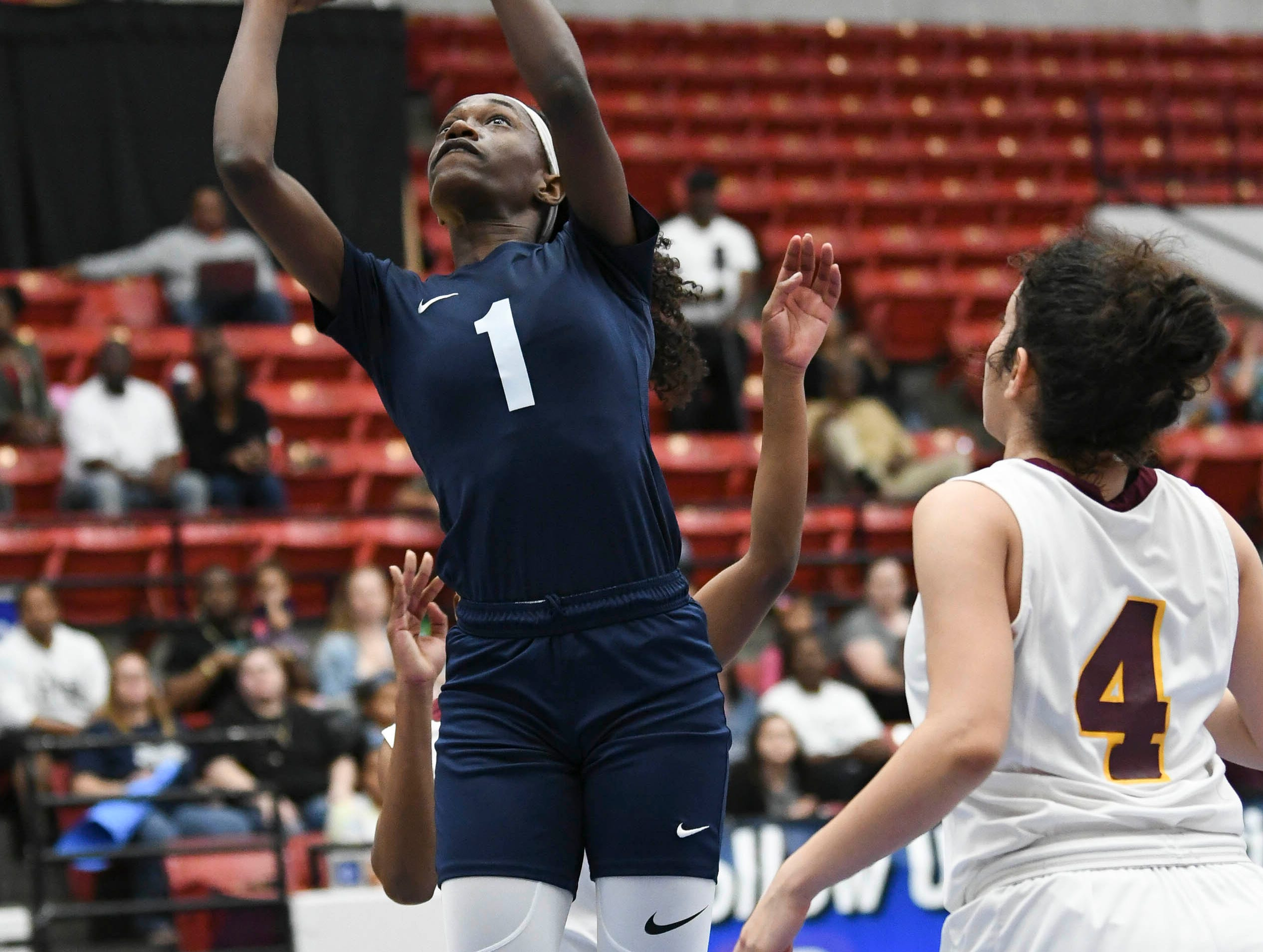 Jayla Johnson of Florida Prep takes a shot during Tuesday's Class 2A state championship game.