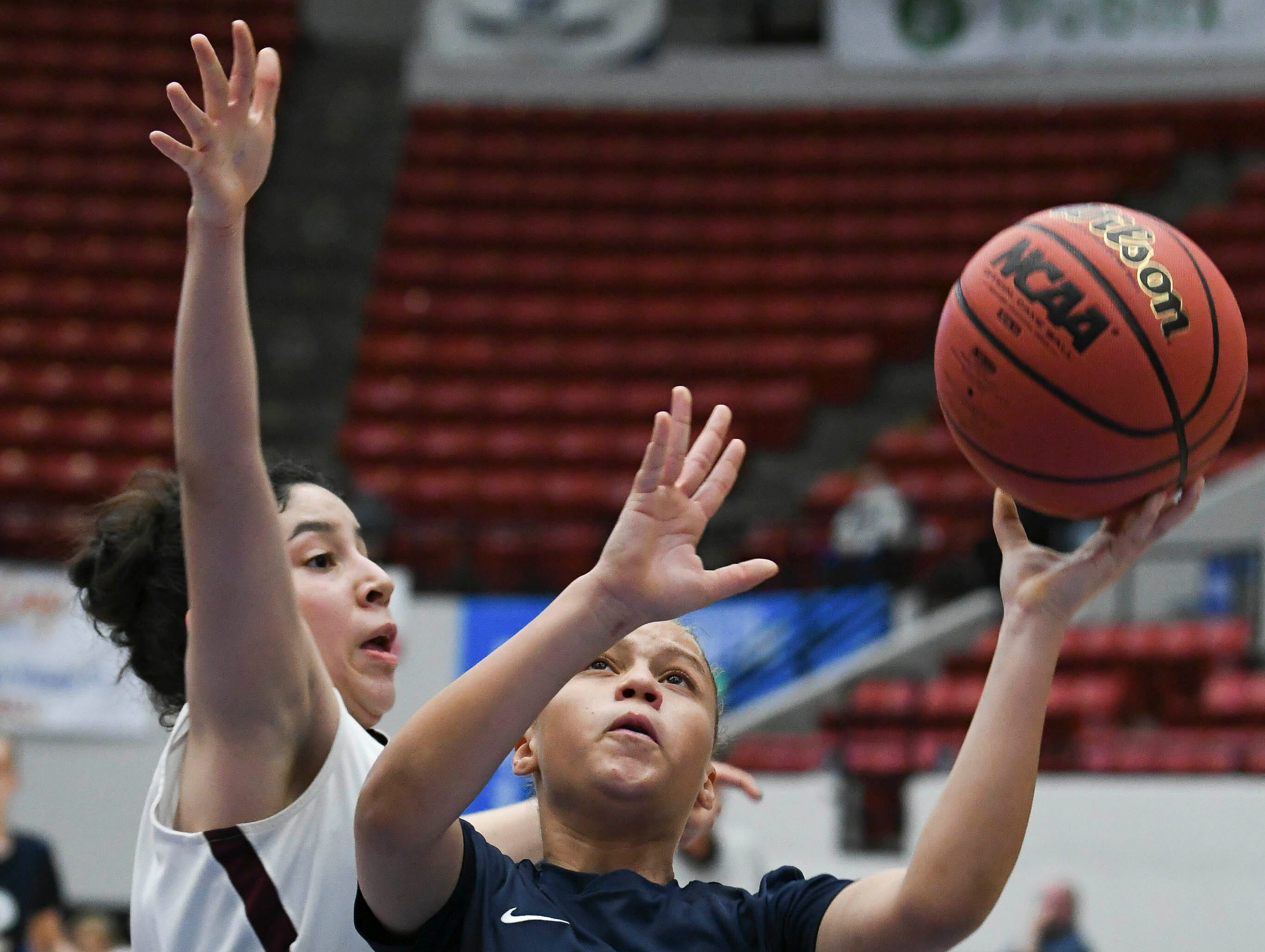 Alonya Walden shoots over Domenica Zamora of Bayshore Christian during Tuesday's Class 2A state championship game.