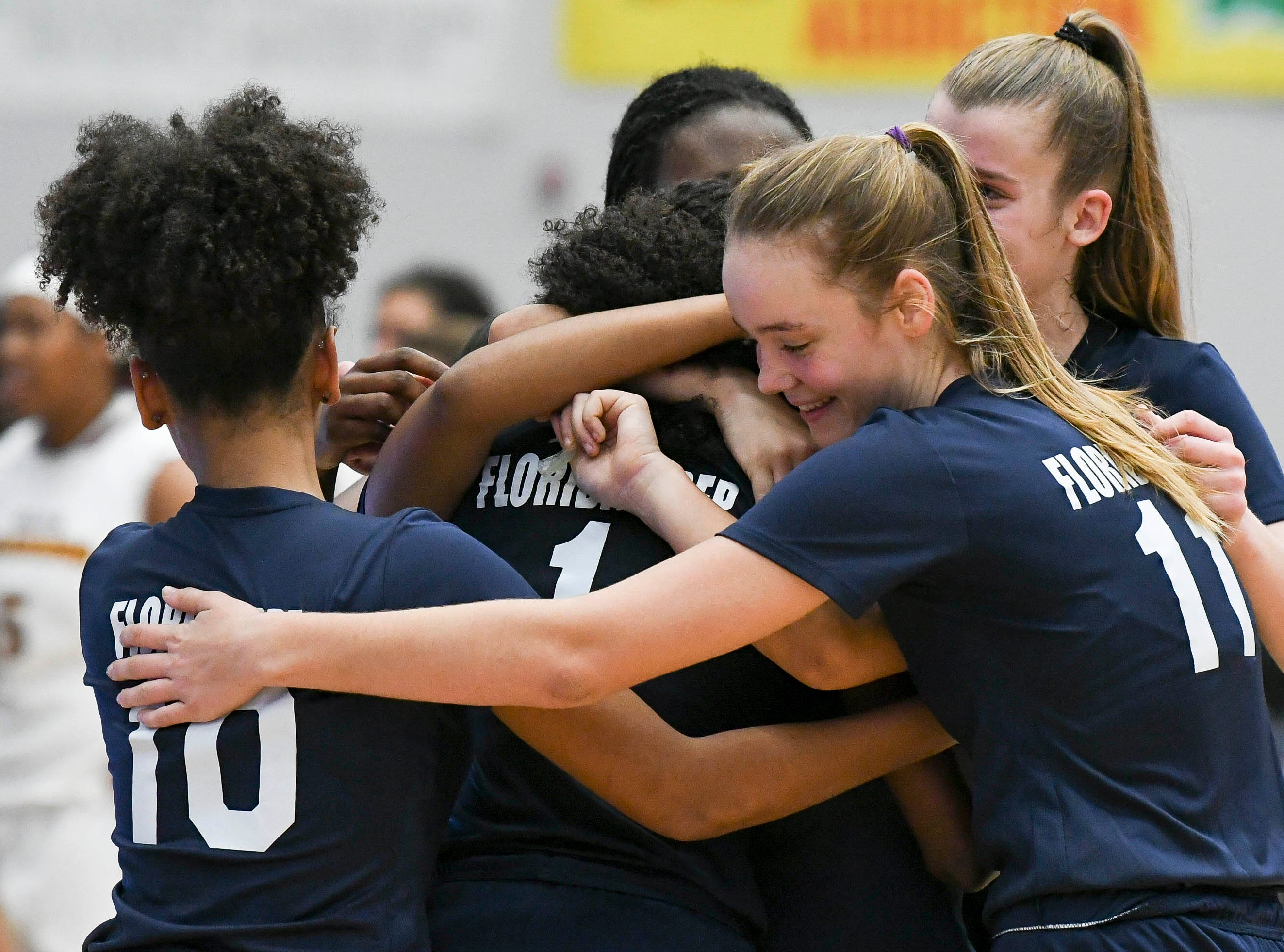 Florida Prep Falcons celebrate their victory over Bayshore in Tuesday's Class 2A state championship game.