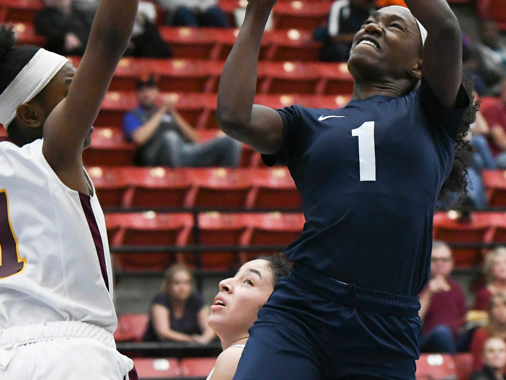 Jayla Johnson of Florida Prep shoots over the guard of Bayshore Christian's Tinnea Johnson during Tuesday's Class 2A state championship game.