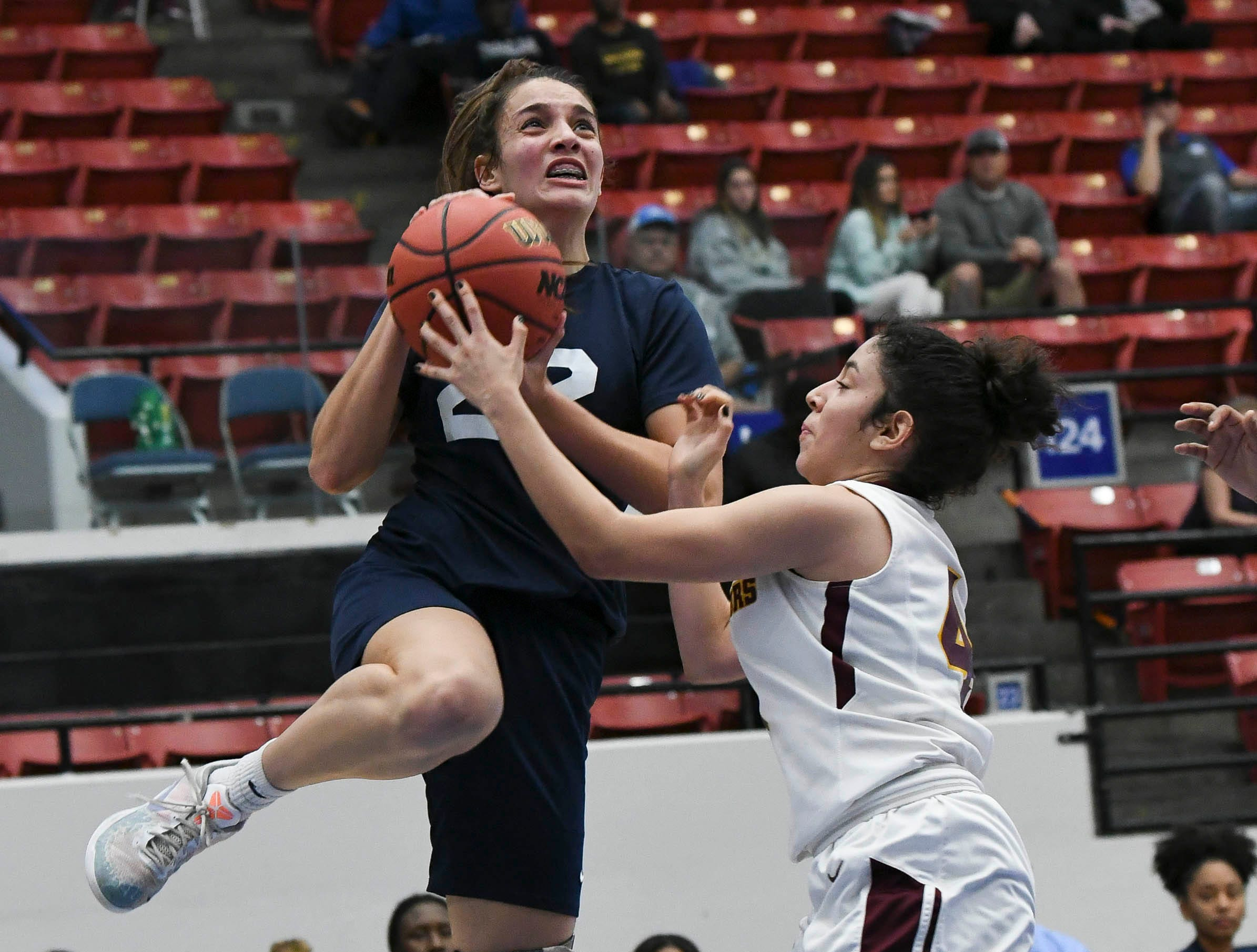 Aleah Sorrentino of Florida Prep is fouled by Domenica Zamora of Bayshore Christian during Tuesday's Class 2A state championship game.