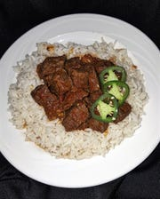 Zilzil is Ethiopian-style beef tips with peppers, cardamom, fenugreek and onions.