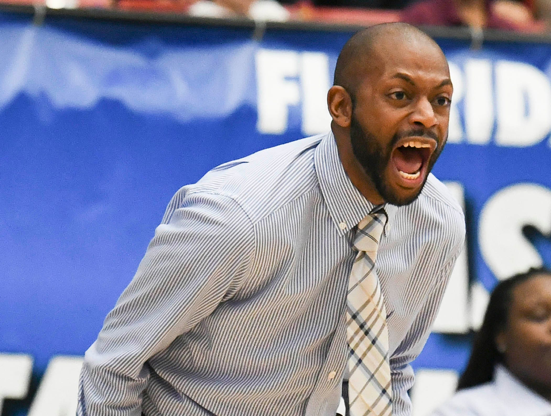Florida Prep basketball head coach EJ ''''''''Murray yells to his players during Tuesday's Class 2A state championship game.