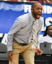 Florida Prep basketball head coach E.J. Murray yells to his players during the Class 2A state championship game.
