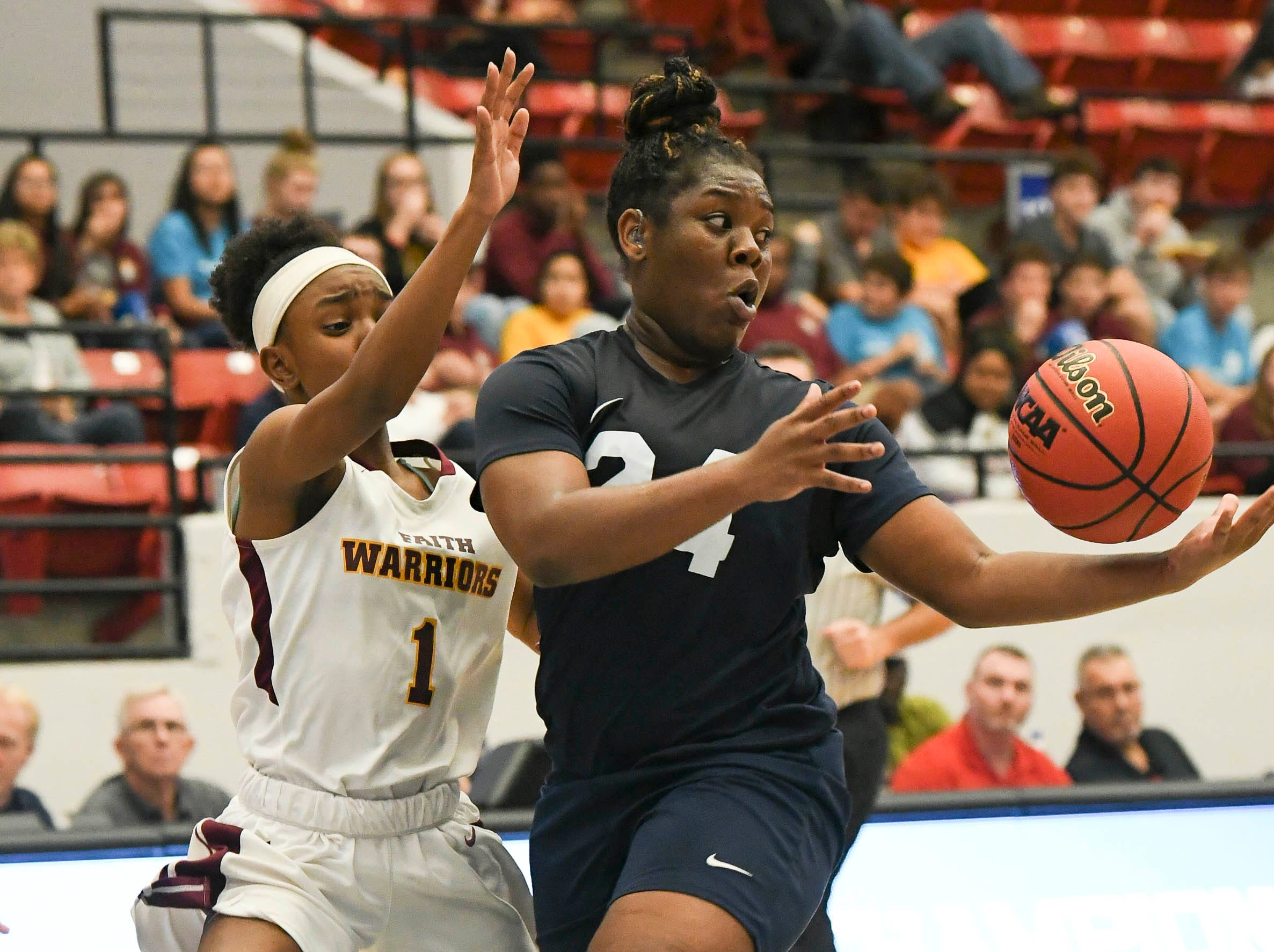 Ashaunti Rolle of Florida Prep passes away from the guard of Bayshore Christian defender Tinnea Johnson during Tuesday's Class 2A state championship game.