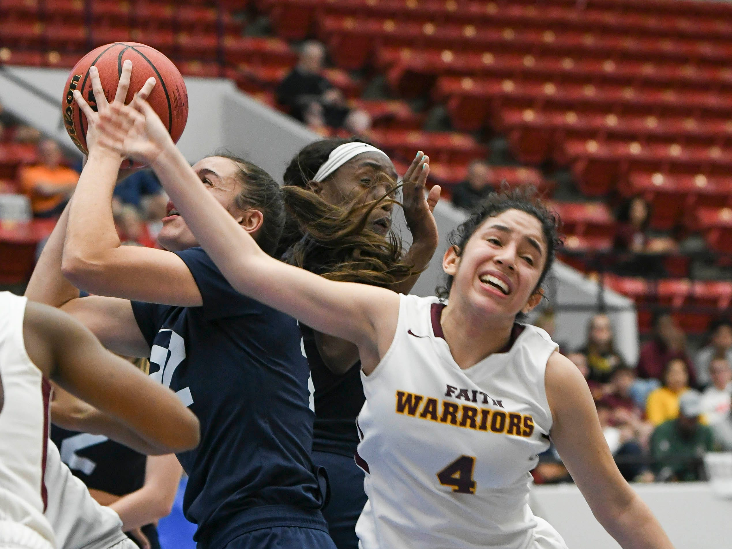 Aleah Sorrentino of Florida Prep (22) grabs a rebound from Domenica Zamora of Bayshore Christian during Tuesday's Class 2A state championship game.