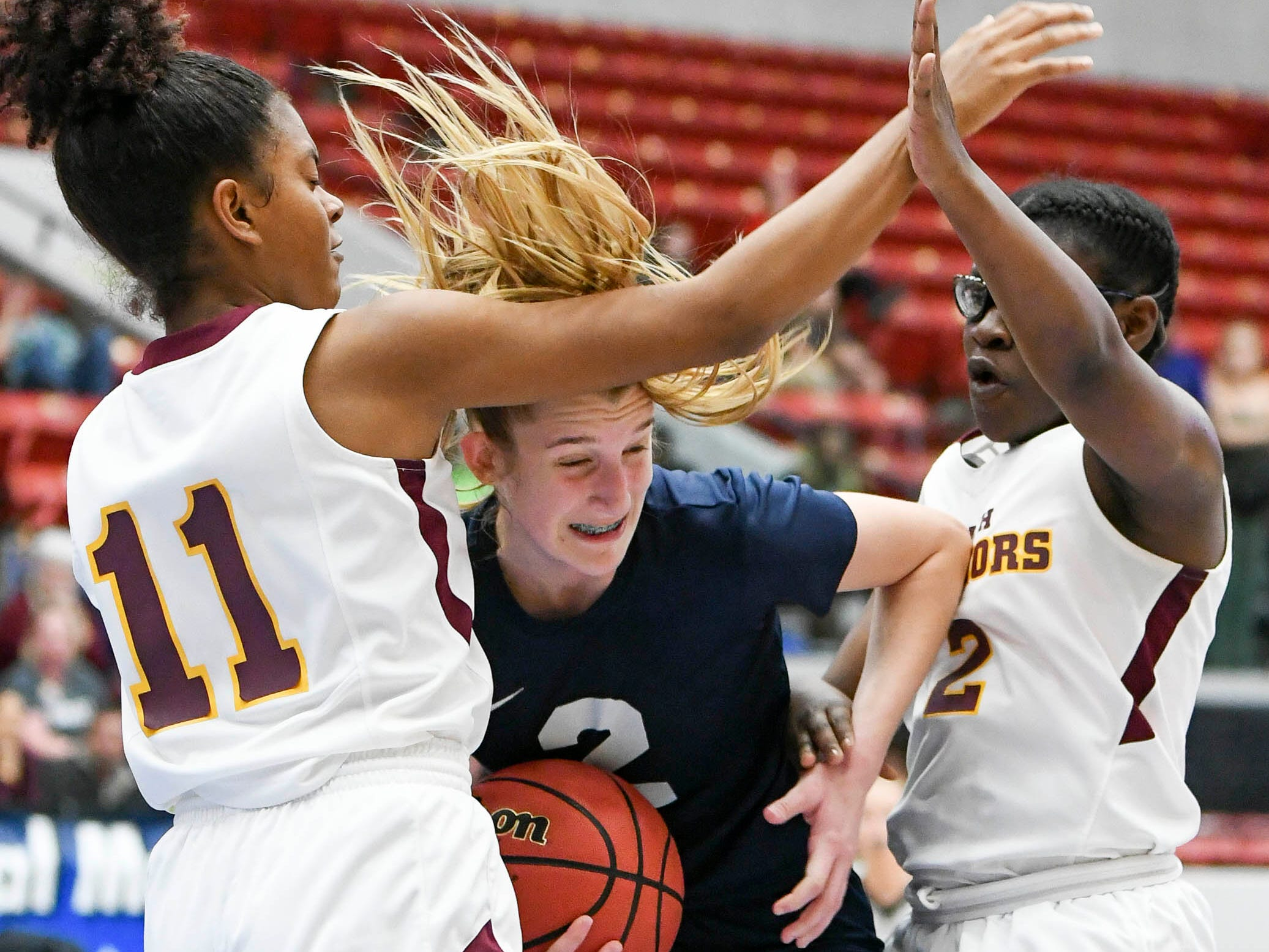 Emma Risch of Florida Prep struggles to keep a rebound from Sierra Bell (11) and Ari Royal (2) of Bayshore Christian during Tuesday's Class 2A state championship game.