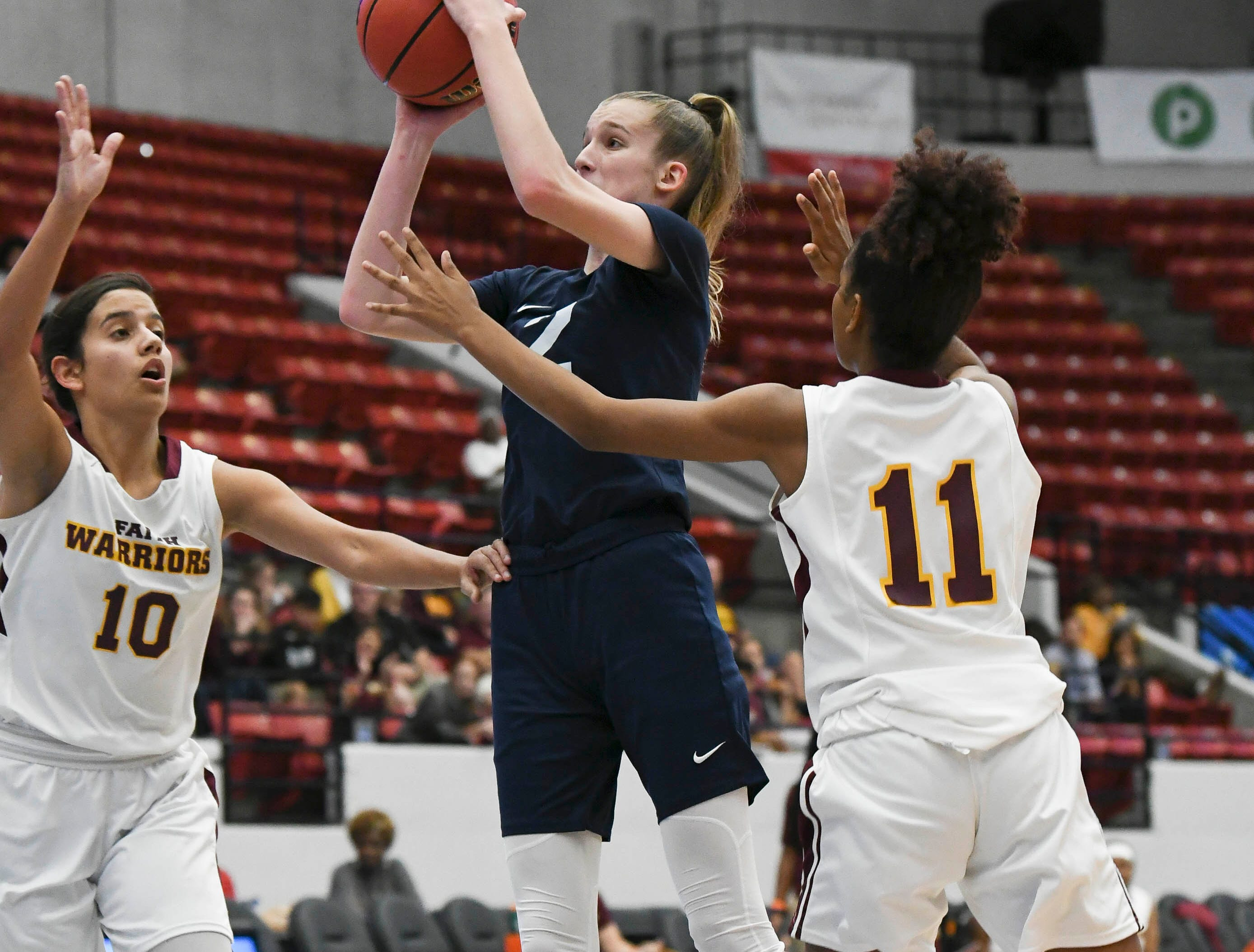 Emma Risch of Florida Prep shoots through Bayshore Christian defenders Fabiana Limongi (10) and Sierra Bell (11) during Tuesday's Class 2A state championship game.
