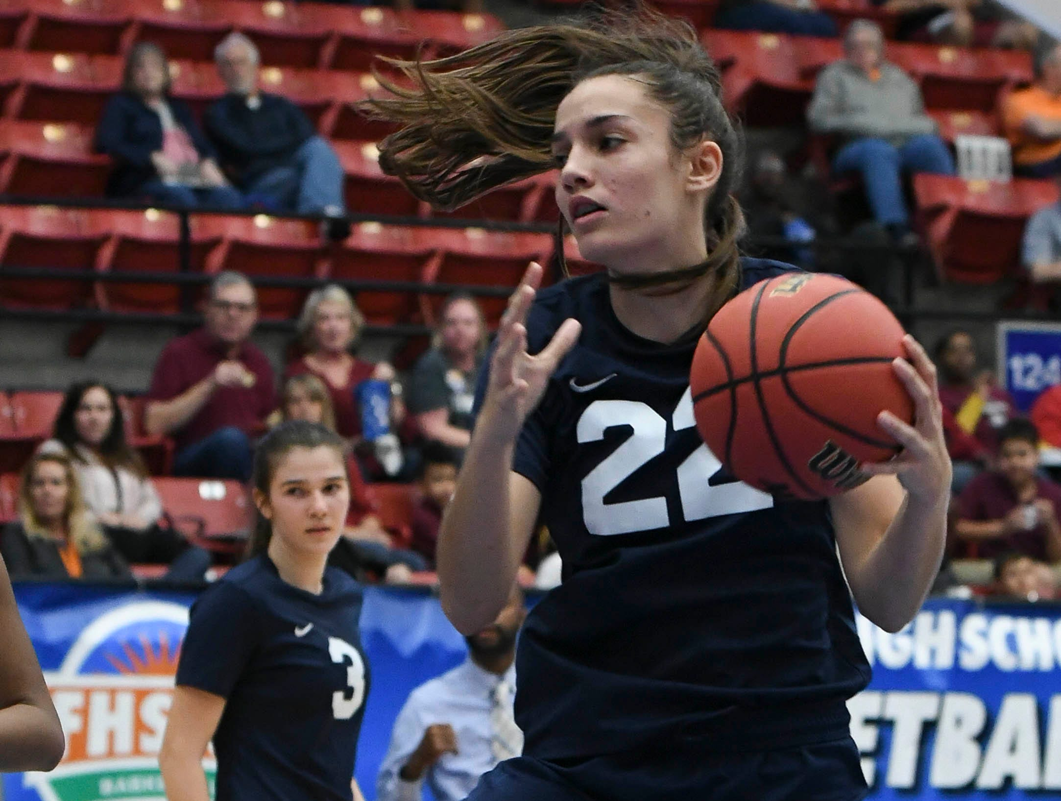 Aleah Sorrentino of Florida Prep grabs a rebound during Tuesday's Class 2A state championship game.