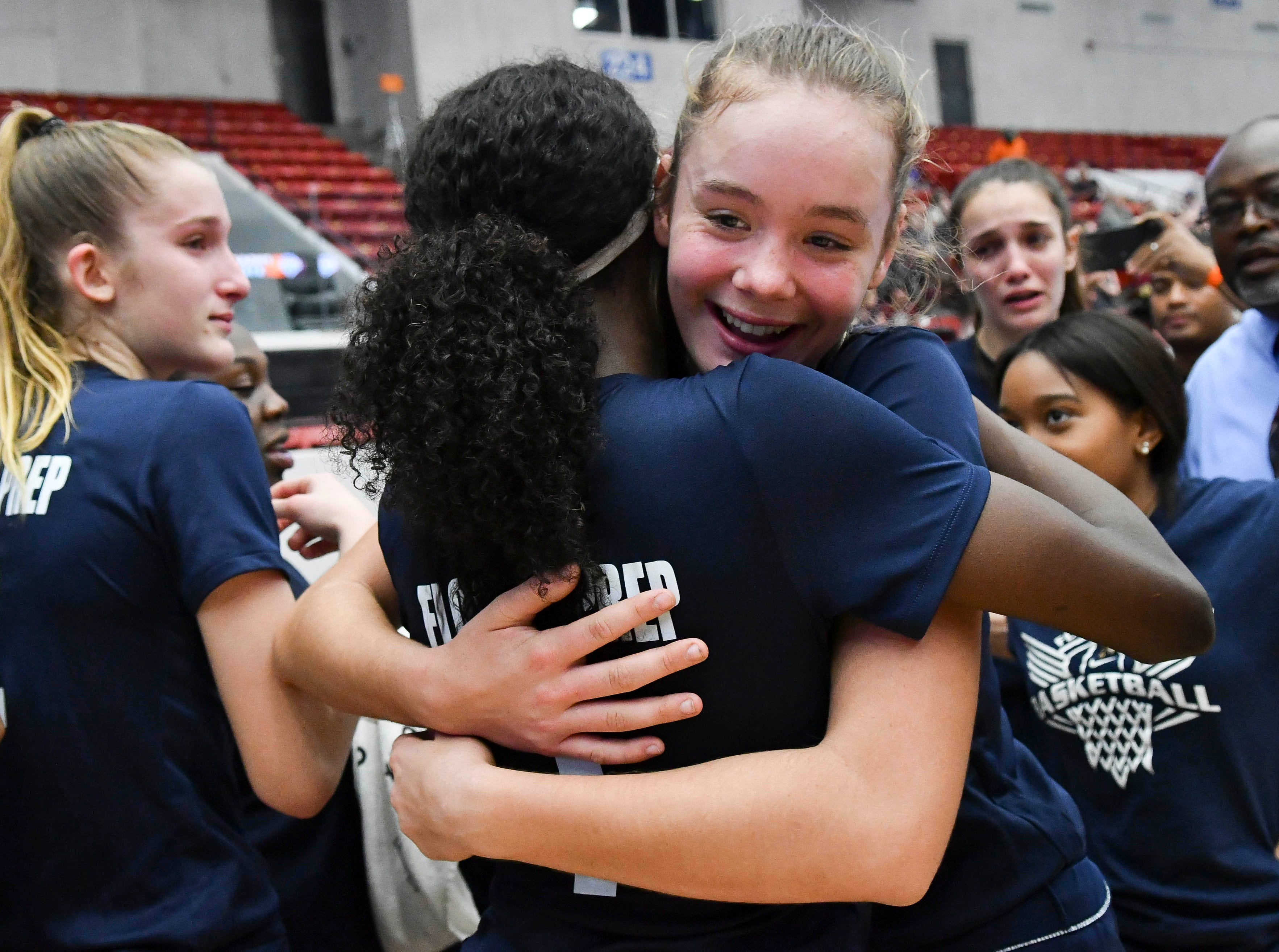 Jayla Johnson and Katelynn Hagy of Florida Prep hug after the Falcons won Tuesday's Class 2A state championship game.