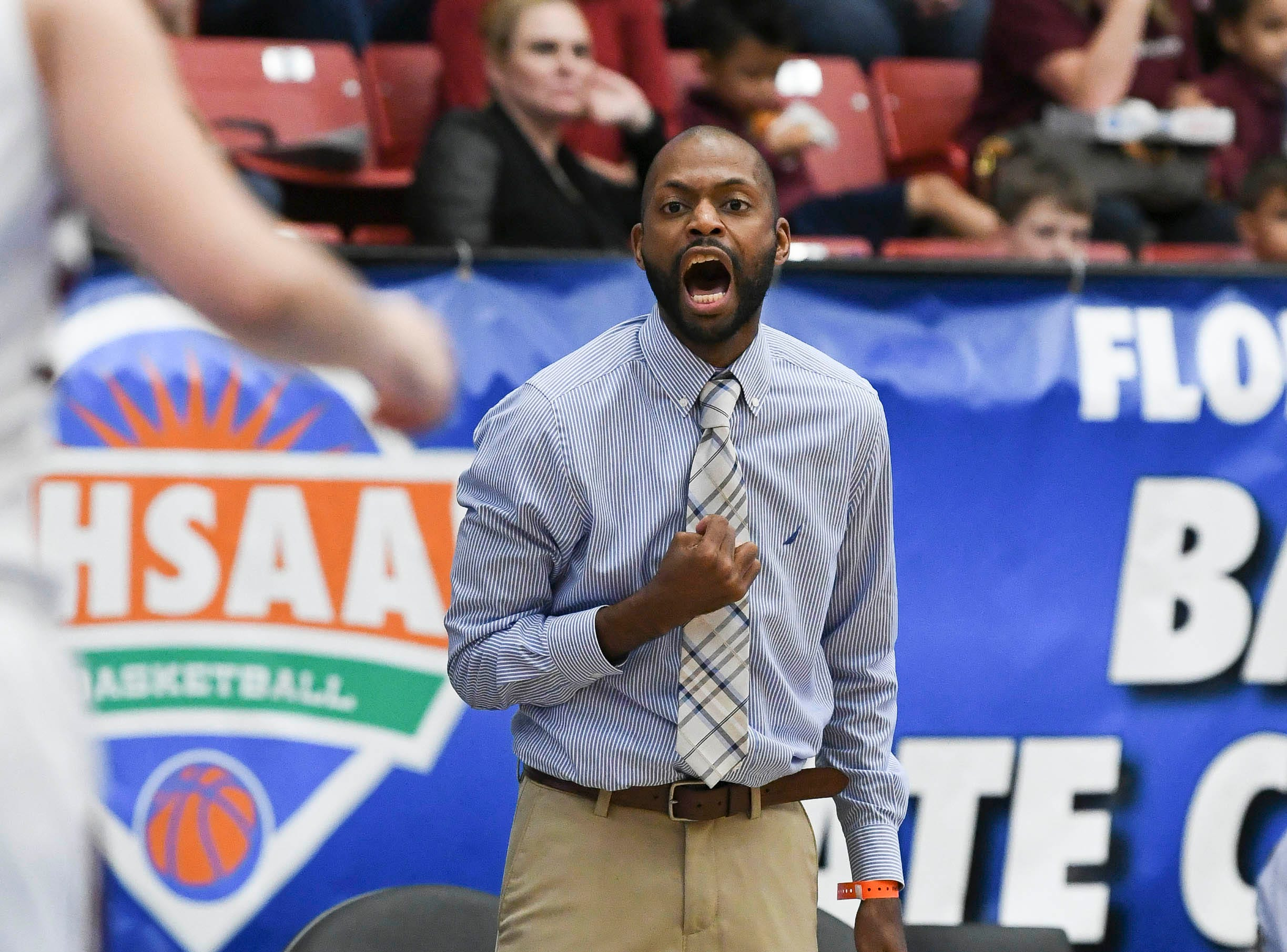 Florida Prep girls basketball head coach EJ Murray yells instructions to his players during Tuesday's Class 2A state championship game.