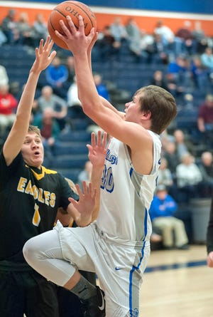 Crestline's Calvin Reed soars to the basket.