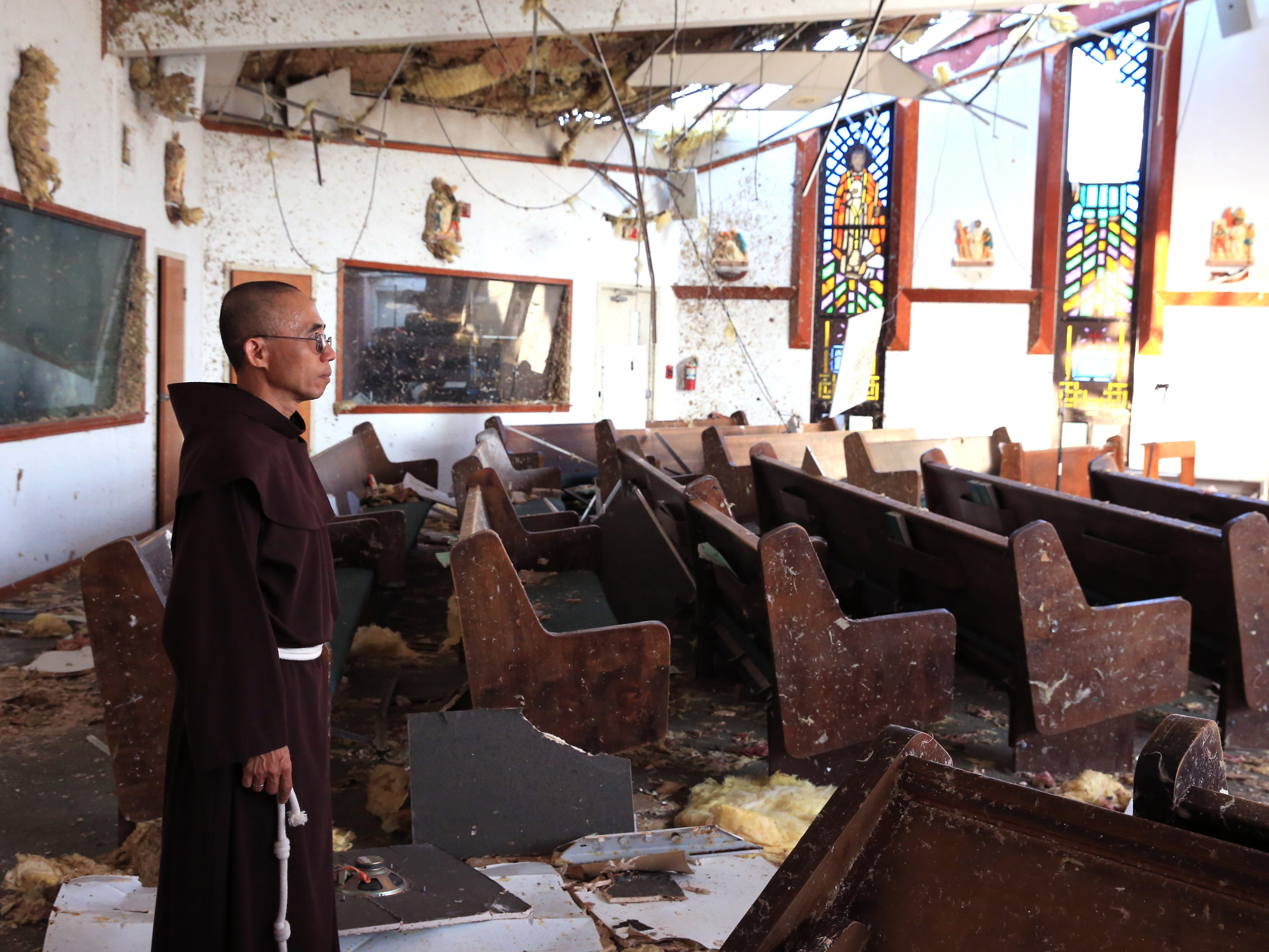 Fr. John Tran Nguyen looks around the heavily damaged St. Peter Catholic Church in Rockport on Thursday, September 14, 2017. The church was damaged during Hurricane Harvey. Nearly 18 months after the hurricane, the church is still decimated.