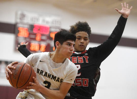 Kingsville's Jacob Villarreal, left, goes for a lay up at the game against West Oso School in the Class 4A regional quarterfinal game, Tuesday, Feb. 26, 2019, in Sinton. West Oso won, 83-74.