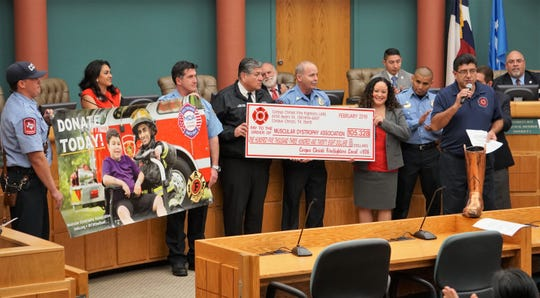 Members of the Corpus Christi Professional Firefighters Association on Feb. 26, 2019 display a check showing the amount the group raised for the Muscular Dystrophy Association in 2018 during their Fill the Boot campaign.
