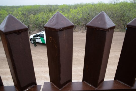 A Border Patrol vehicle seen through the bollard fence near Penitas, TX, on Tuesday, Feb. 28, 2019.