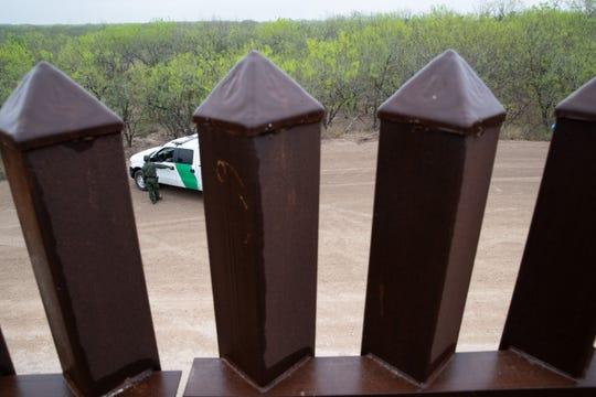 A bollard fence lines the border near Penitas, Texas.