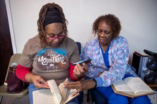 ocelyn Etti (left) and Hattie McKnight search for music for songs to sing during a choir rehearsal at St. Paul Missionary Baptist Church in Rockport on Feb 2. The church is one of dozens of churches and other houses of worship that sought help from the federal government in the aftermath of Hurricane Harvey. This is the first disaster in which houses of worship have been eligible for public assistance under the Federal Emergency Management Agency.