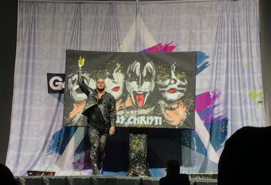 Performance painter David Garibaldi donated his KISS-inspired painting to Metro Ministries after the rock band's last concert in Corpus Christi. The nonprofit will auction the painting online until Monday, March 4.