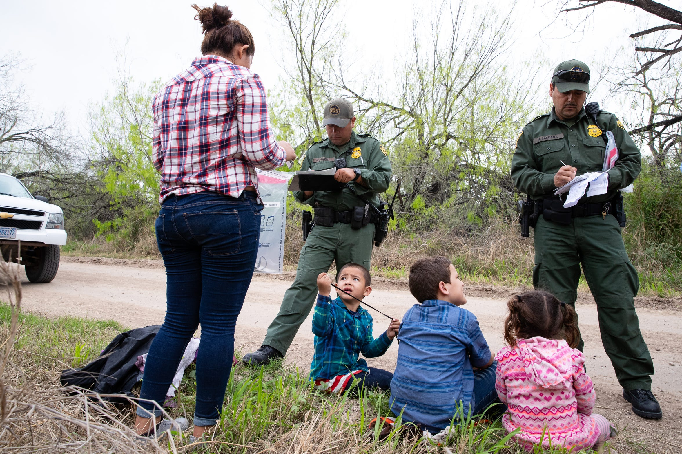 Border Patrol Agents take in to custody migrants shortly after crossing the river from Mexico near Mission TX, on Tuesday, Feb. 28, 2019.