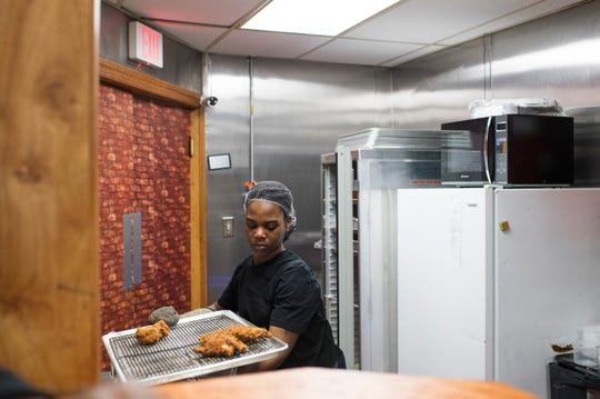Zee Meadows works in the kitchen at Taste of SOUL in Burlington City, N.J. The restaurant opened in January.