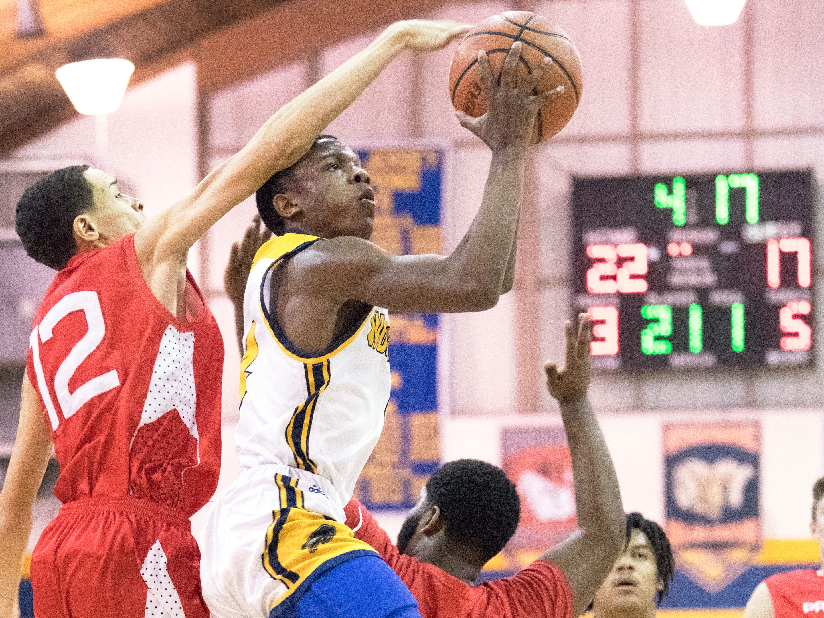 Woodbury's Tommy Carter shoots in front of  Paulsboro's Lamonte Smith during the 2nd quarter of the South Jersey Group 1, first round boys basketball playoff game played at Woodbury High School on Tuesday, February 26, 2019.   Woodbury defeated Paulsboro, 69-41.