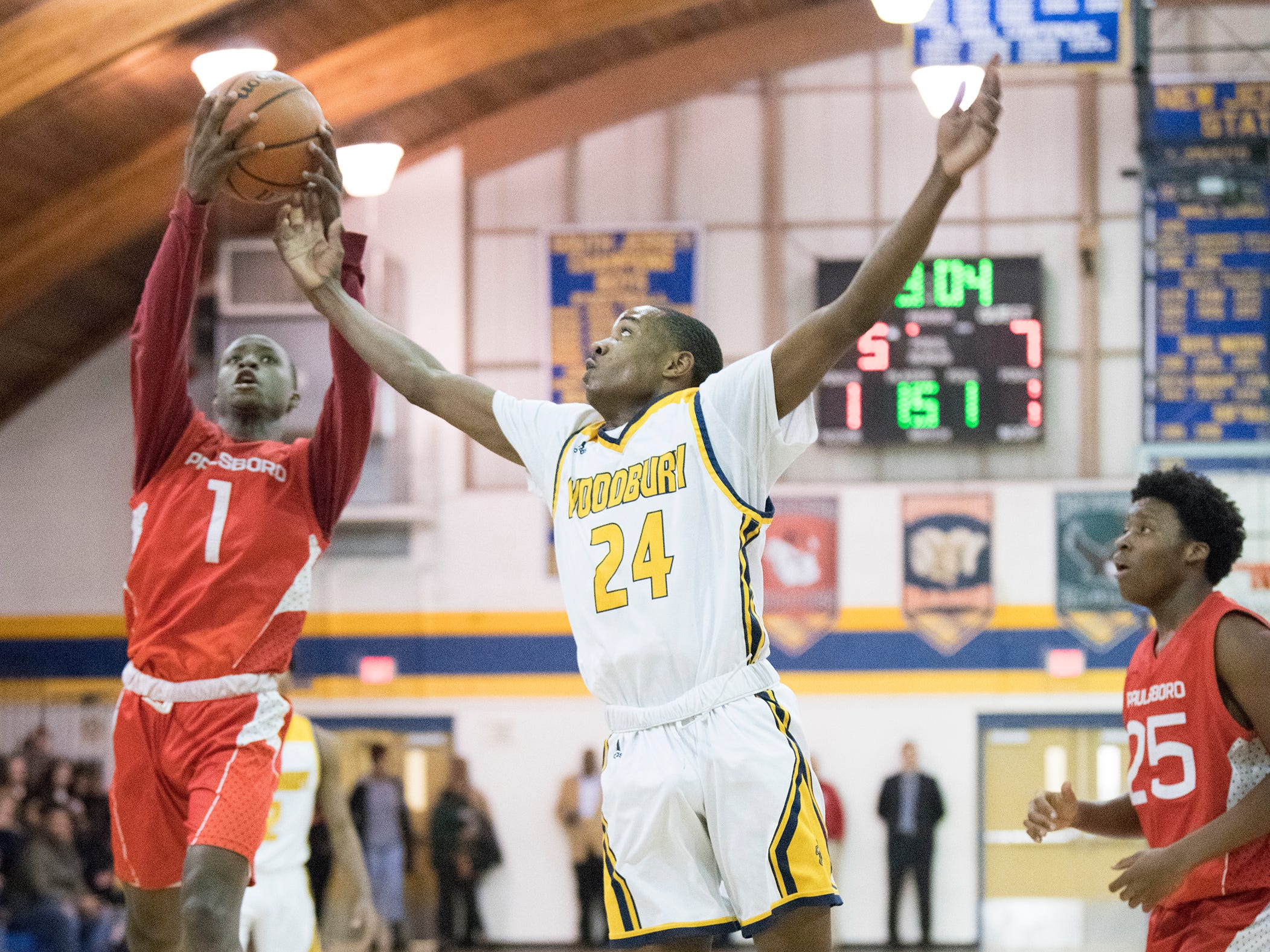 Paulsboro's Keyshun Sanders grabs a rebound next to Woodbury's Rahjan Thomas during the 1st quarter of the South Jersey Group 1, first round boys basketball playoff game played at Woodbury High School on Tuesday, February 26, 2019.   Woodbury defeated Paulsboro, 69-41.