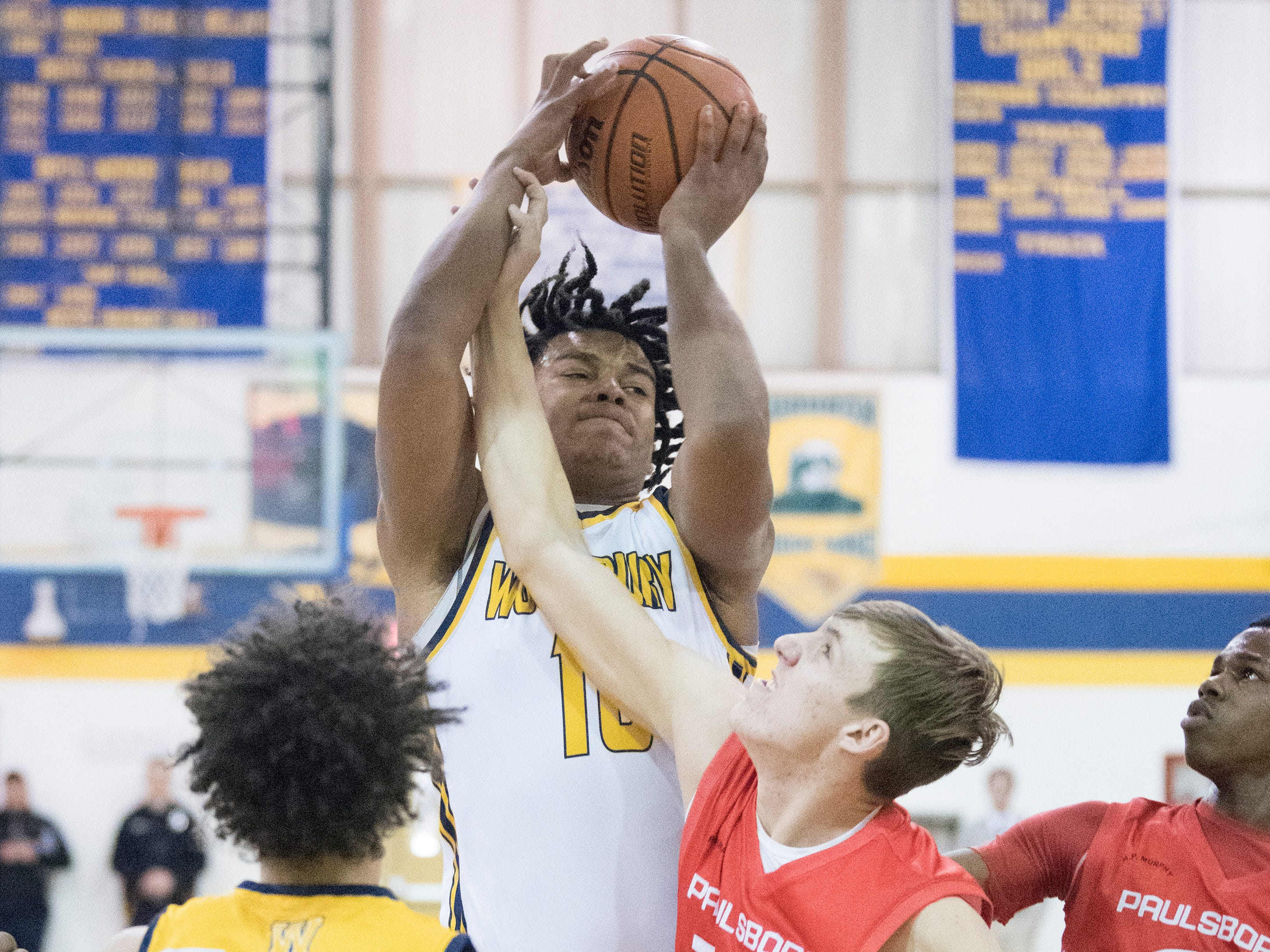 Woodbury's Isaiah Bailey grabs a rebound during the 2nd quarter of the South Jersey Group 1, first round boys basketball playoff game between Woodbury and Paulsboro, played at Woodbury High School on Tuesday, February 26, 2019.   Woodbury defeated Paulsboro, 69-41.