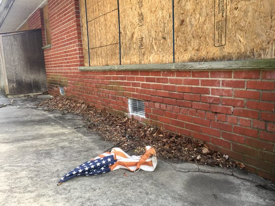 A forgotten flag, which has since been removed, lies on a pathway at the former Bancroft complex in Haddonfield.