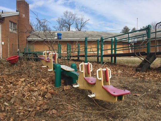 A see-saw sits in an abandoned playground at the former Bancroft site in Haddonfield.