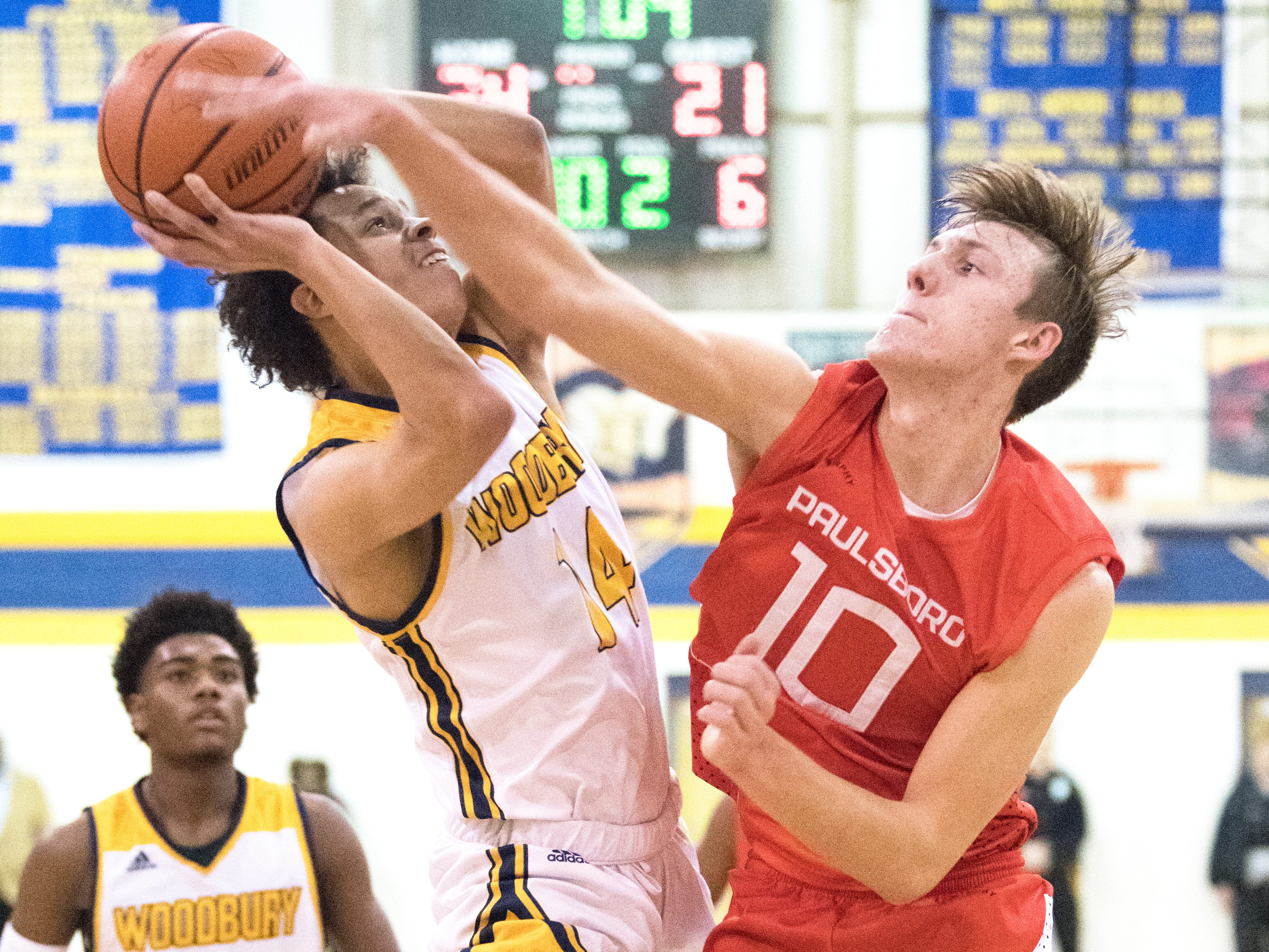 Woodbury's  Richard Oakley is fouled by Paulsboro's Nick Pellegrini during the 2nd quarter of the South Jersey Group 1, first round boys basketball playoff game played at Woodbury High School on Tuesday, February 26, 2019.   Woodbury defeated Paulsboro, 69-41.