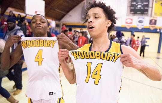 Woodbury's Tommy Carter, left, and Woodbury's  Richard Oakley celebrate Woodbury's 69-41 win over Paulsboro in the South Jersey Group 1 first round boys basketball playoff game played at Woodbury High School on Tuesday, February 26, 2019.