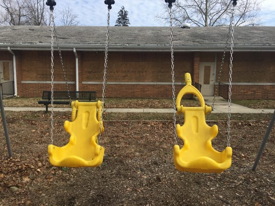 Swings hang in an abandoned playground at the former Bancroft site in Haddonfield.