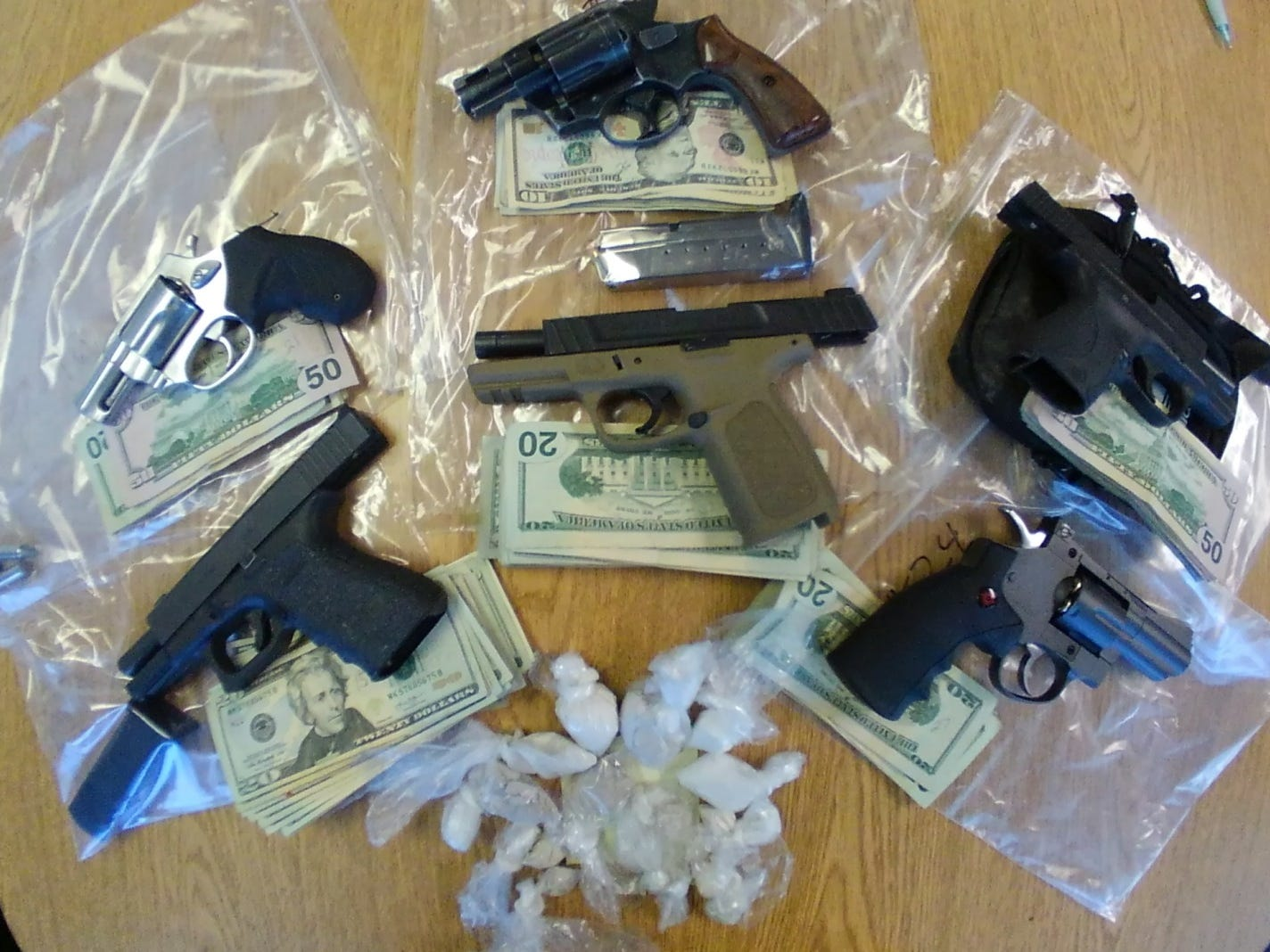 The Chillicothe police reported seizing 78 grams of heroin, 13 grams of methamphetamine, 3 grams of cocaine, 5 loaded handguns, and $3,539.00 in cash during a Feb. 26, 2019, search warrant of a duplex on Hirn Street.