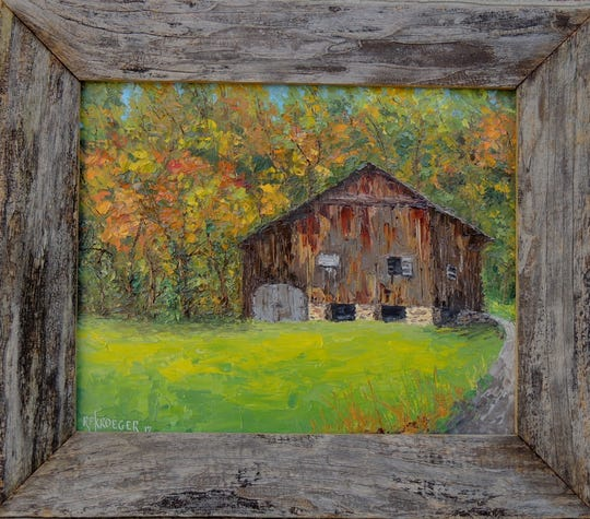 An example of one of Robert Kroeger's paintings that features the image painted on masonite with a frame made from the barn's original wood.