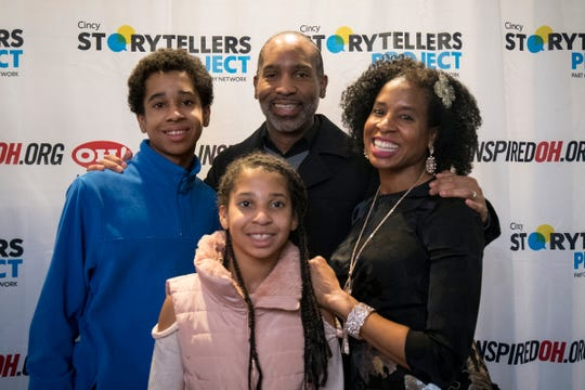 Dara Ward Fairman poses with her family after speaking at the Cincy Storytellers Project: Romance -- or Not at the Transept Tuesday, February 27, 2019 in Cincinnati, Ohio.