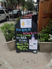 FC Cincinnati fans in New York gather at the Banter Bar in Brooklyn, which even publicizes game on its sidewalk board.