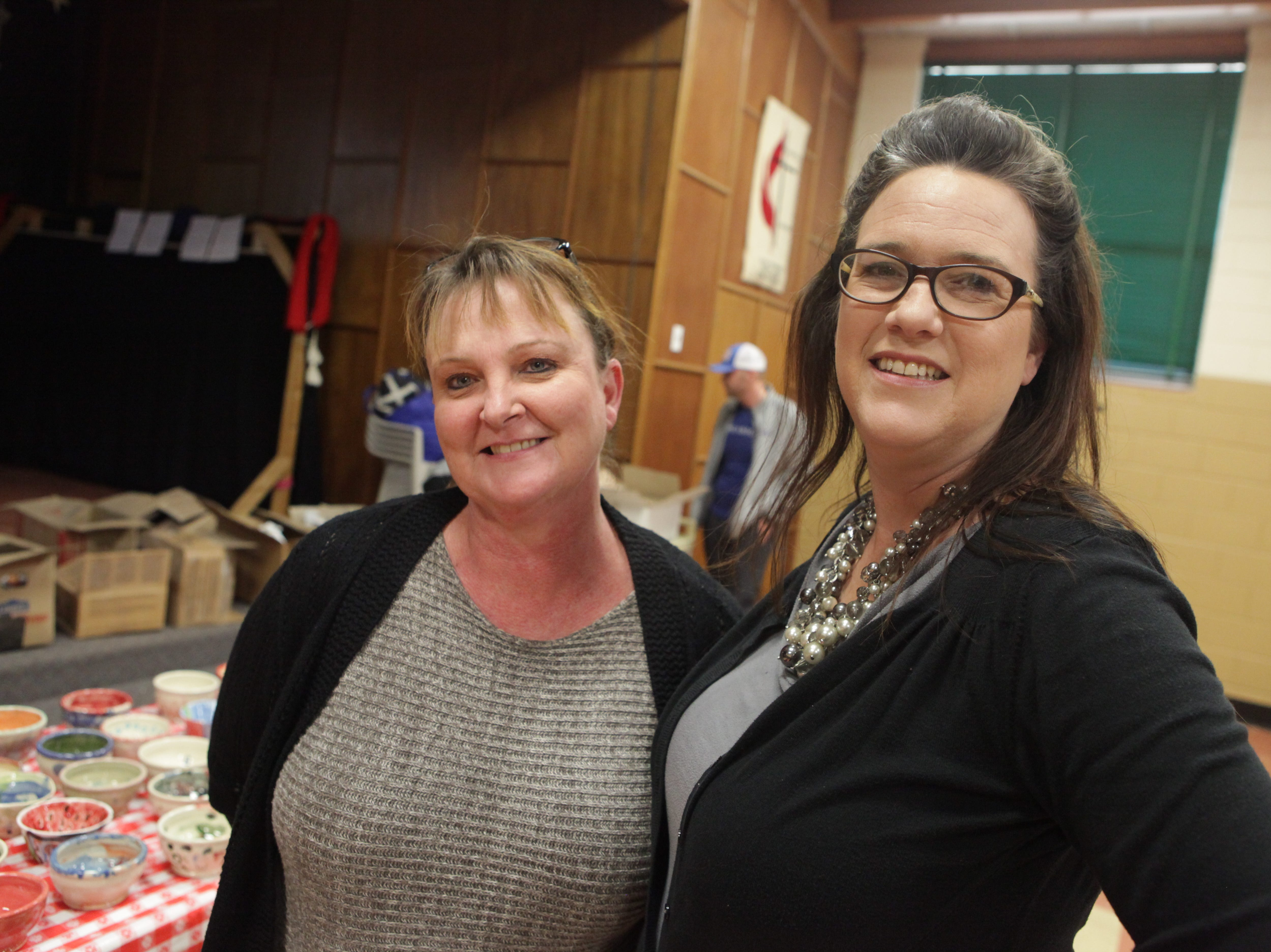 Rebecca Lopez and C. C. Carmack smile during Empty Bowls 2019 at New Providence United Methodist Church.